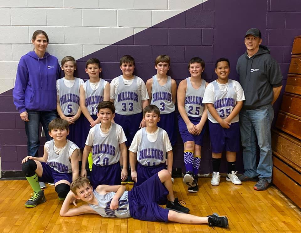 St. Joseph 4th grade Boy Basketball Team with coaches